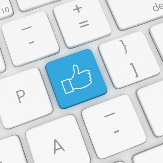 keyboard with a thumb up image key